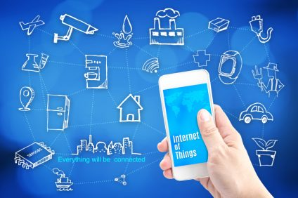 Hand holding smart phone with Internet of things (IoT) word and object icon and blur background, Network Technology concept..